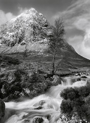 Buachaille Etive Mòr Scotland (welshio) Tags: longexposure travel winter wild sky blackandwhite bw cliff snow mountains film scale nature monochrome beautiful landscape scotland landscapes highlands rocks heather perspective landmarks dramatic scottish stormy rockface scan rapids depthoffield waterfalls rivers glencoe romantic bleak 4x5 remote isolation lonely wilderness peaks waterblur sublime drama lightandshadow isolated largeformat singletree zonesystem munros pictorial winterweather glenetive pushprocess glens cambo crag scottishhighlands 5x4camera buchailleetivemor naturallandscapes agfapan snowyweather scottishlandscapes britishlandscapes altnafeadh classicviews mountainsociety scottishburns
