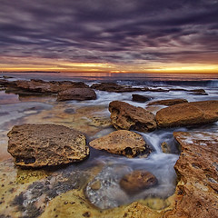 Silky sea flows through textured stone (Kounellis) Tags: ocean longexposure sea sky seascape water rock canon seascapes sydney wideangle nsw cronulla waterscape waterscapes 50d 10mm22mm kounelli