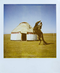 Horsman and yurt in Song-Kol lake, Kyrgyzstan (Eric Lafforgue) Tags: horse lake grass polaroid cheval ride tent kyrgyz rider kyrgyzstan tente yourte kirghizistan kirgistan songkol lafforgue kirghizstan kirgisistan  yourta    chenval quirguizisto
