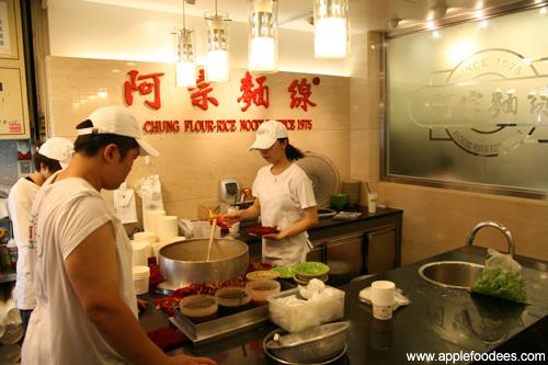 Workers preparing noodles
