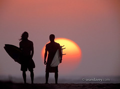 silhouetted surfers at Sunset Beach, north shore, Oahu, Hawaii (Sean Davey Photography) Tags: color horizontal northshore surfers sunsetbeach seandavey beachphotograph tropicalpictures surflifestyle finephotographyart surfnorthshore picturessurfers imagessurf photographersfineart silhouettessurferssunsetbeachnorthshoreoahuhawaiisunsetsnthshoreoahuusa