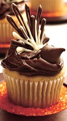 Thanksgiving Turkey Cupcakes Recipe (Betty Crocker Recipes) Tags: thanksgiving autumn party fall cake guests festive recipe dessert sweet chocolate decorative hersheys cupcake sugary frosting entertaining bakedgoods bakedgood bettycrocker yellowcake chocolatekiss woodplate orangesugar thanksgivingturkeycupcakes