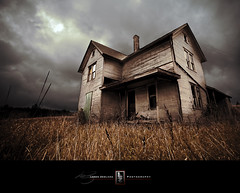 Haunted House On Happy Hill (Loren Zemlicka) Tags: old autumn windows sky white house history fall abandoned home grass wisconsin clouds farmhouse rural photography photo october midwest image decay farm empty country neglected picture haunted explore porch vacant worn homestead aged discarded 2009 deserted canonef1740mmf4lusm dilapidated baraboo rundown antiquated rickety unoccupied canoneos5d flickrexplore saukcounty happyhill lorenzemlicka