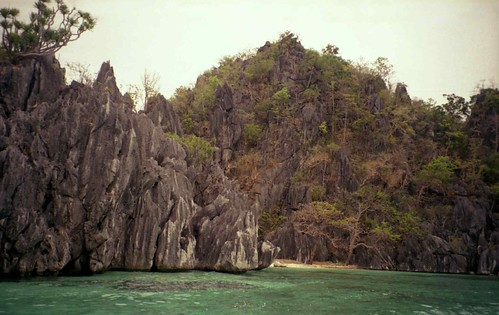Lagoon with beach and limestone pinnacles; Coron Island, Busuanga, N. Palawan, Philippines by Lon&Queta