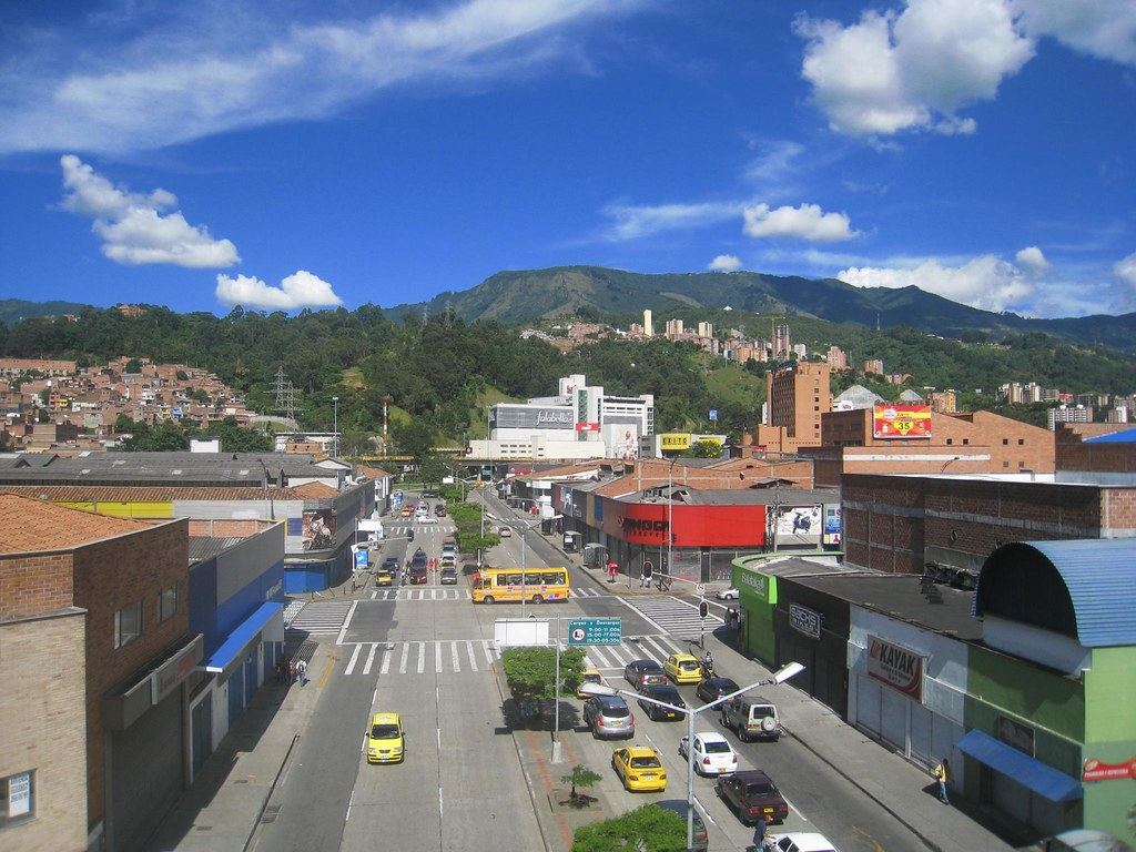 Green Andean mountains form the perfect backdrop for the San Diego mall (white building).
