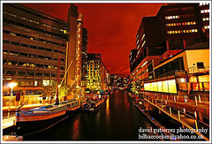 London Paddington Basin at Night ~ It was a Red Night over the Canal...~ (david gutierrez [ www.davidgutierrez.co.uk ]) Tags: city uk red sky urban color reflection building london architecture night buildings dark geotagged photography boat canal office cityscape darkness dusk sony centre cities cityscapes center structure basin architectural explore nighttime page londres nights paddington metropolis alpha 1001nights residential topf100 frontpage londra soe dt nightfall municipality edifice paddingtonbasin sheldonsquare britishwaterways blueribbonwinner f4556 supershot 100faves 1118mm flickrsbest sonyalpha grandjunctioncanal anawesomeshot superaplus flickraward theperfectphotographer sonyalpha350 sonya350 alpha350 inspiredbyyourbeauty worldsartgallery platinumpeaceaward magicunicornverybest trolledproud ikawaypinoy photocreativity sonyalphadt1118mmf4556 sony350dslra350