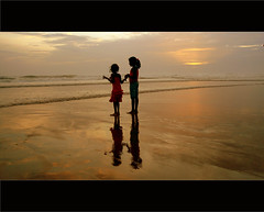 hold on together ! (Robin George) Tags: sunset red sea india beach childhood kids sisters reflections moment silhoutte veli trivandrum beachbreeze velitouristvillage mtrtrophyshot reflectionslovers