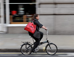 Big red bag 2 (jeremyhughes) Tags: city red woman london cycling nikon cyclist 85mm commuter commuting nikkor rider handbag folder foldingbike cityoflondon redbag squaremile foldie d700 bigredbag