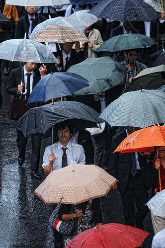 Not a happy chappy: crowds in the typhoon, Shinagawa, Tokyo.