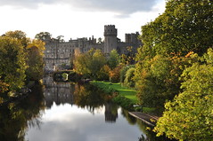 Warwick Castle (JRT ) Tags: bridge autumn trees windows sky building brick water grass stone clouds nikon jetty medieval relflection warwick turrets warwickshire warwickcastle riveravon d90 thegalaxy johnwarwood flickrjrt