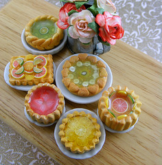 Tarts and Pies (Shay Aaron) Tags: flowers party food house scale kitchen rose fruit pie crust table dessert miniature lemon doll counter handmade aaron fake mini polymerclay fimo bakery tiny pastry faux shay grapefruit resin tart 12th 112 wateringcan dollhouse petit  twelfth tartlet        shayaaron
