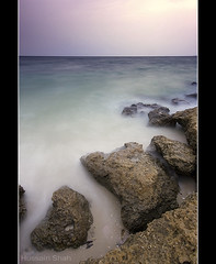 Abu Hulaifa Beach (Hussain Shah.) Tags: sunset beach d50 nikon rocks gulf sigma shore kuwait 1020mm shah hussain حسين شاه ndx8 abuhulaifa