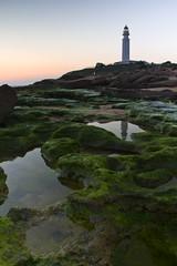 Reflejos del Faro (jaocana76) Tags: sunset lighthouse faro atardecer trafalgar cadiz rocas barbate caosdemeca estrechodegibraltar cabotrafalgar canoneos7d mygearandme juanantonioocaa jaocana76