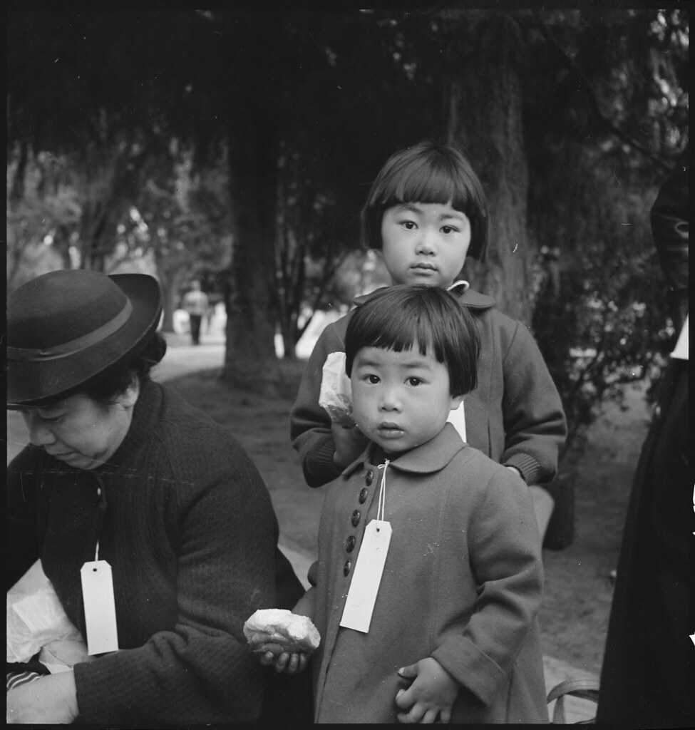 Two Children of the Mochida Family, with Their Parents, Awaiting Evacuation Bus