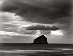 Cape Kiwanda, the other Haystack Rock (Zeb Andrews) Tags: ocean sea bw film beach rock clouds oregon dark landscape moody horizon pacificocean pacificnorthwest brooding oregoncoast seastack pacificcity capekiwanda pentax6x7 bluemooncamera zebandrews bobstraubstatepark zebandrewsphotography