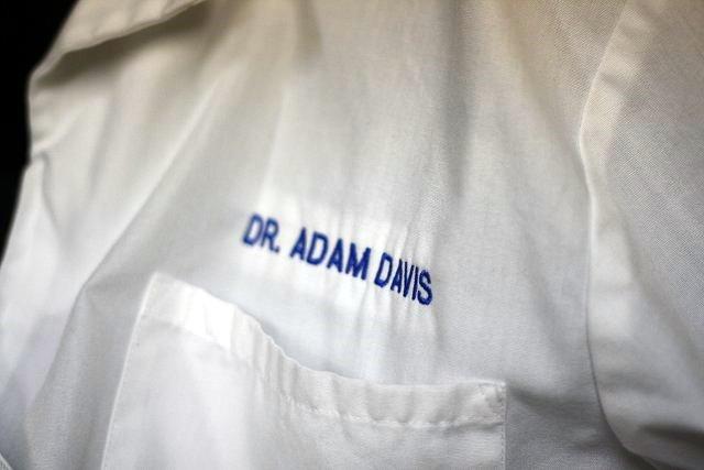 Dr. Adam Davis white coat