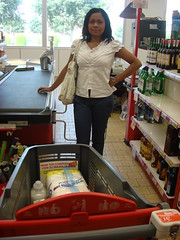 Woman at Check Out Counter with Plastic Shopping Cart. (Polycart) Tags: light red woman green comfortable self shopping out handle one store check long all silent counter trolley rfid gray environmental dia supermarket plastic whole single friendly service block safe easy cart grocery piece stores eco carts groceries checkout supermarkets trolleys compact automated recyclable robust polypropylene hypermarket p180 lasting hypermarkets