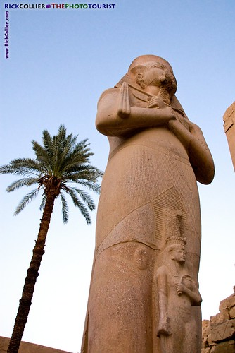 A statue of Ramses III and his queen towers in the courtyard at Karnak Temple, near Luxor, Egypt