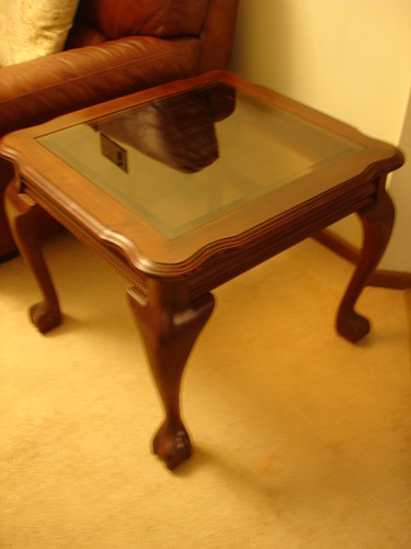 Stylish Brown lounge room Side Coffee Table with Glass Top. Perfect Condition. Brought from Myer for $300 and am now selling for only $120 ONO.  You won't find a better quality table for this price ag