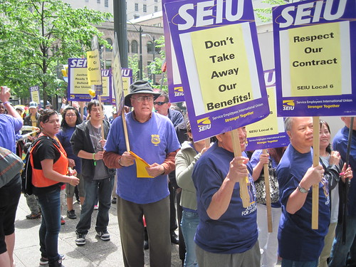 Janitors march in the streets of Seattle against benefit and wage cuts