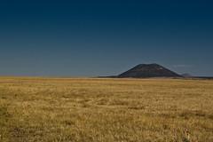 Capulin (okbeatnik) Tags: blue sky mountain newmexico field grass volcano flat raton plains stark capulin cotrip08