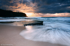 Dramatic Sunrise at Turimetta Beach (-yury-) Tags: ocean sea sky sun beach water clouds sand rocks sydney wave australia nsw cokin abigfave turimetta