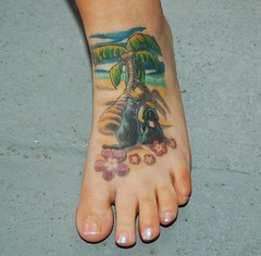 marisa's new foot tattoo (That Nikon Girl) Tags: ocean dog tattoo ink cat palm palmtrees hibiscus halos inked foottattoo hawaiianflowers animaltattoo