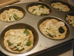 Cheese me. (merelythemoon) Tags: cheese mushrooms pizza onions spinach pizzadough alfredosauce muffintins minideepdishpizza