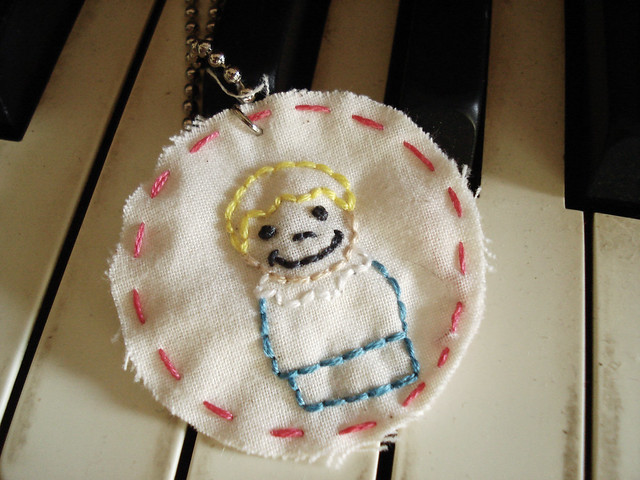 embroidered charm