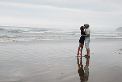 To break up the black and white (Brittany Chavez) Tags: ocean blue boy reflection love beach water girl oregon grey holding kiss kissing waves romance shorts tiptoes arcadiabeach barelegs romantickiss