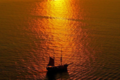 Sail Away..... (Atilla2008) Tags: sunset water beautiful silhouette gold golden ripple calm santorini greece serene sailaway volcanic clipper shimmering shimmer outstanding caique sunsetcruise becalmed placestoseebeforeyoudie