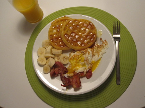 Waffles, bacon, eggs and banana slices, OJ