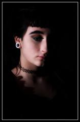 Pensive Mood (tina777) Tags: chelsea pensive mood girl woman female model low key portrait piercings choker earring nose ring black dark studio lighting photoshop elements ononesoftware