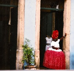 Around South America (16) (The Spirit of the World) Tags: baianas ladies women locals shop shopkeeper salvadorbahia brazil southamerica shopowner unescoworldheritagesite street streetscene door doorway print film analogphotography hoopeddresses slavery africa