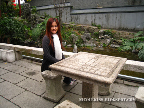 sitting at stone chess table