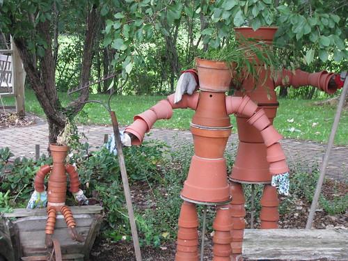 Statues using plant pots