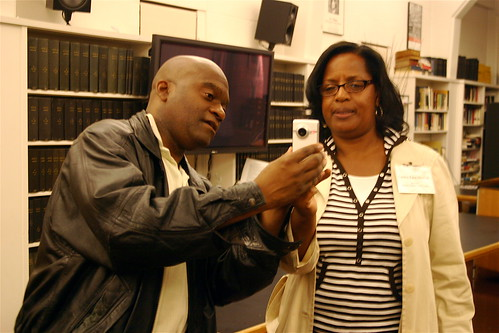 Zennie Abraham shows Lanita Pace-Hilton his Flip camera