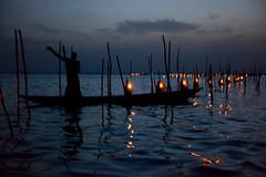 Fishing net lights at dawn. Cotonou, Bnin, Africa. (E. B. Sylvester) Tags: africa shadow lake man fire dawn lights fishing atmosphere unusual laguna nets afrique bnin cotonu ebsylvester
