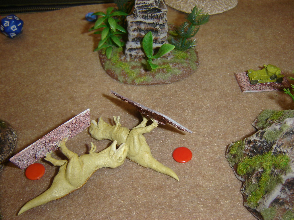 Second Tyrranosaur grievously wounded as it charges across open ground