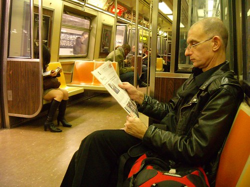 Man Newspaper subway_