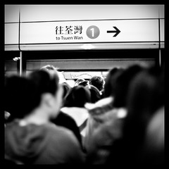 Miles ahead (terencehonin) Tags: people bw hk white black hongkong 50mm crowd busy mf 香港 crowded f12 mtr 地鐵 繁忙