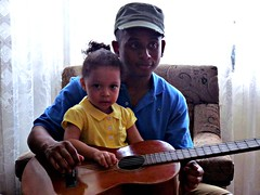 Plucking Out a Melody (Reinalasol) Tags: portrait people playing portraits pose flickr faces guitar posed human panama ang 2009 humans chirriqui april2009 panama2009 reinalasol marfos