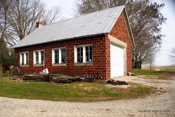 3 red brick garage