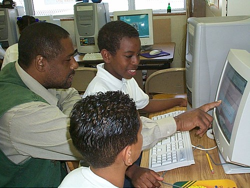 Teacher working with kids by breity, on Flickr
