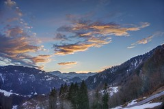 Last rays of the day in the Swiss Alps (PeterThoeny) Tags: schuders switzerland mountain alps snow day dusk sunset pink cloud cloudy outdoor graubünden grisons landscape 3xp raw nex6 photomatix selp1650 hdr qualityhdr qualityhdrphotography sky fav100
