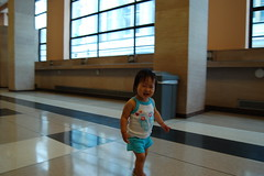 Aki walking down the longest post office hall