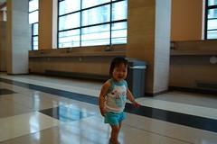 Aki walking down the longest post office hall