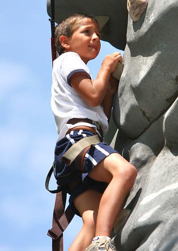 Wyatt climbing a rock wall