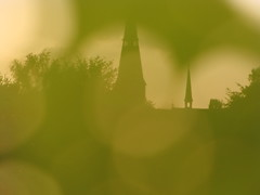 church through leaves (soliwo) Tags: sunset green church netherlands leaves europe wetlands flare moors riel gloaming transparant framedbyleaves riverley