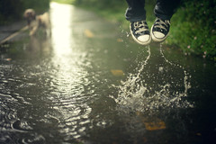 """Children look down, then leap for new puddles...""  -E. Able (moiht) Tags: wet puddle jump julie awesome downpour soaking torrential photographyisnothingwithouttakingrisks"